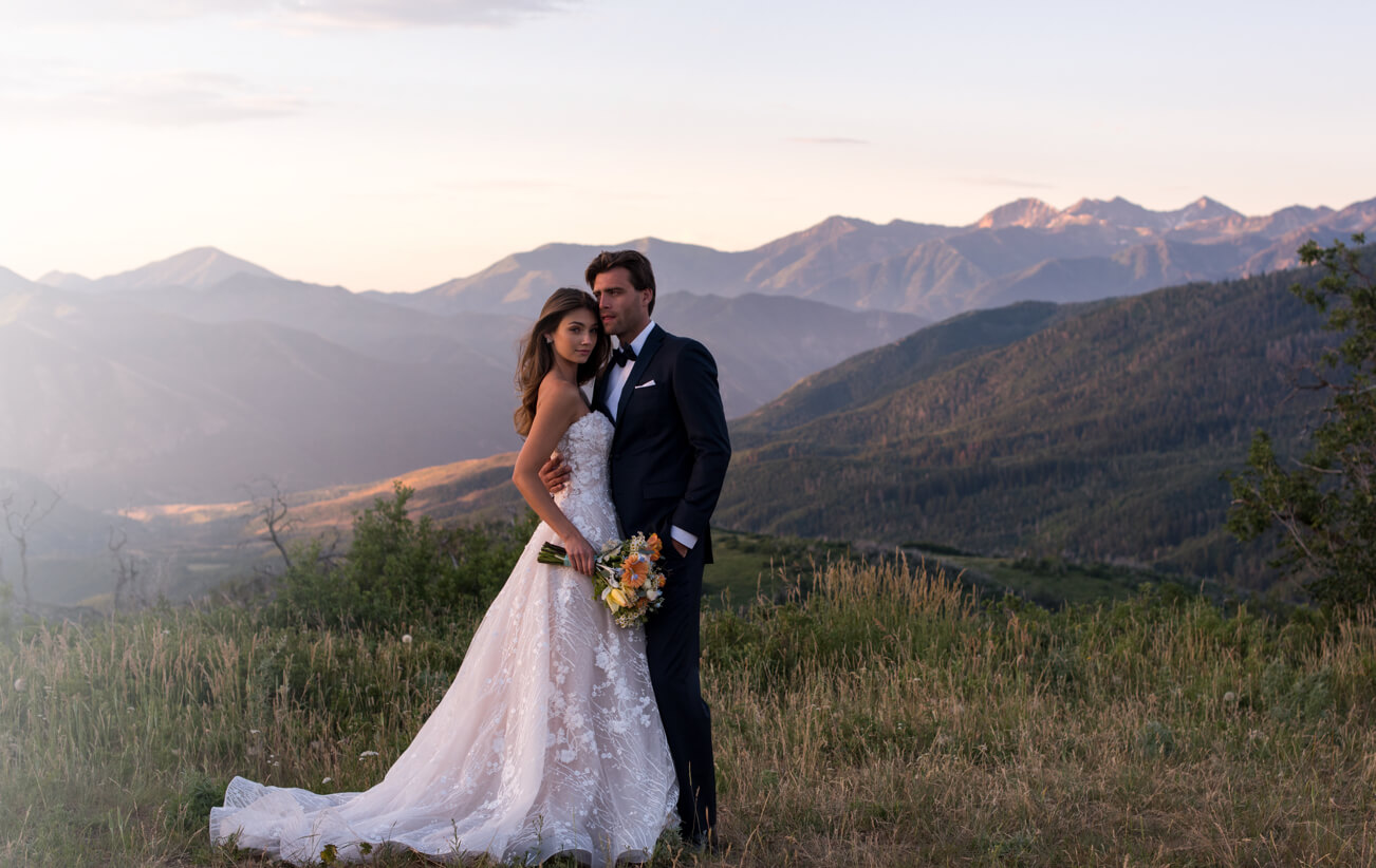 Bride and Groom surounded by mountains