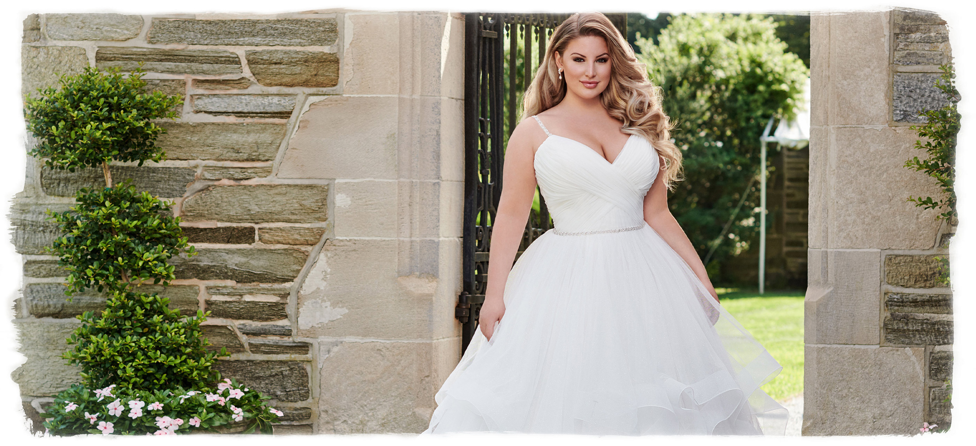 Blonde plus size bride in white dress