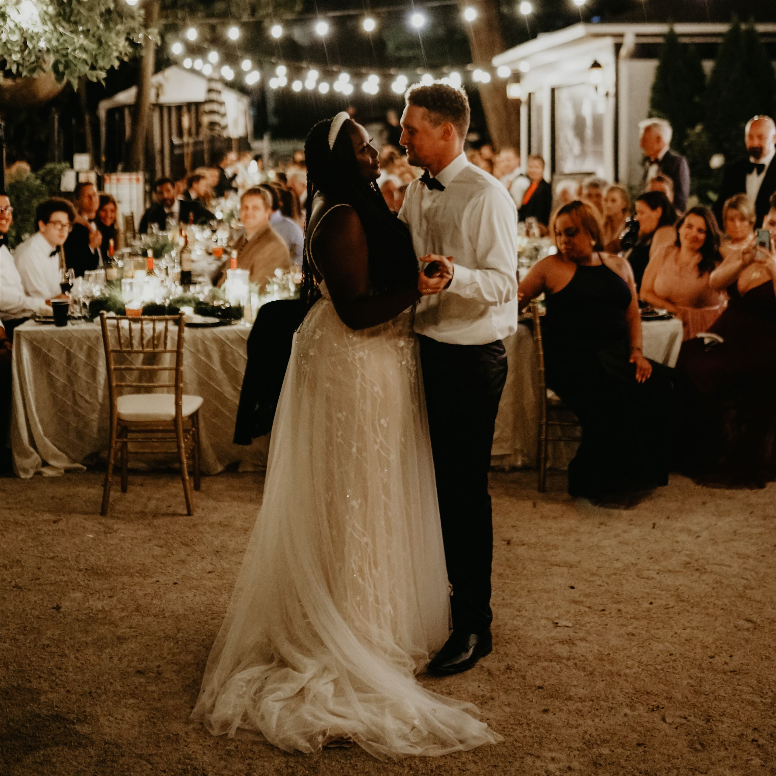 Bride and groom dancing together after their wedding reception