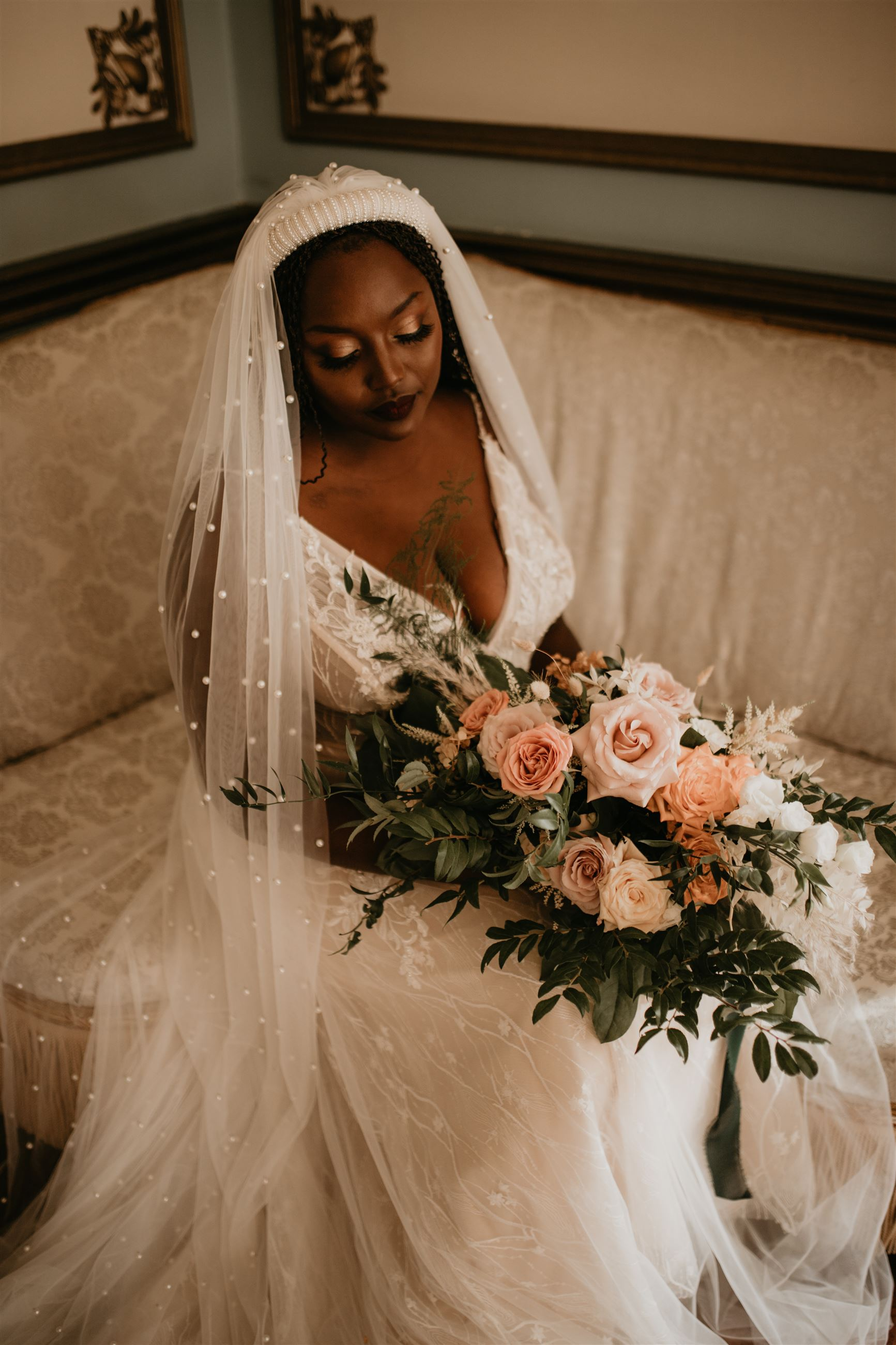 Bride wearing Martin Thornburg and holding her floral bouquet