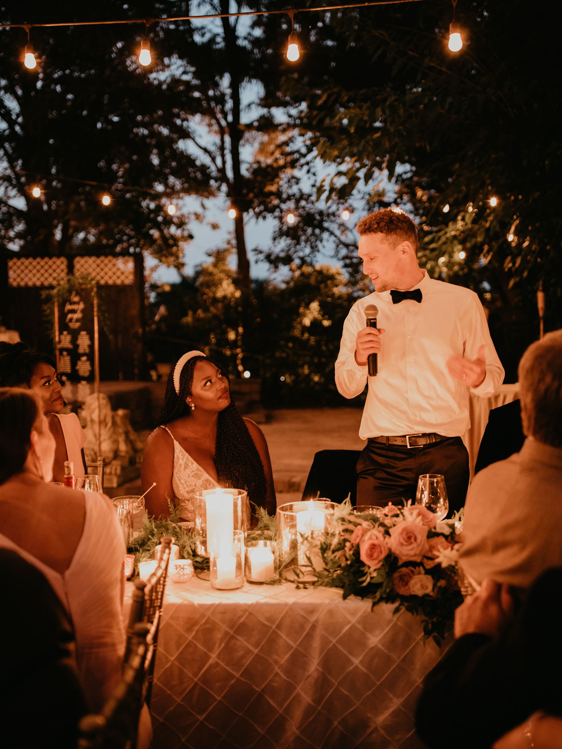 Groom giving speech after wedding ceremony