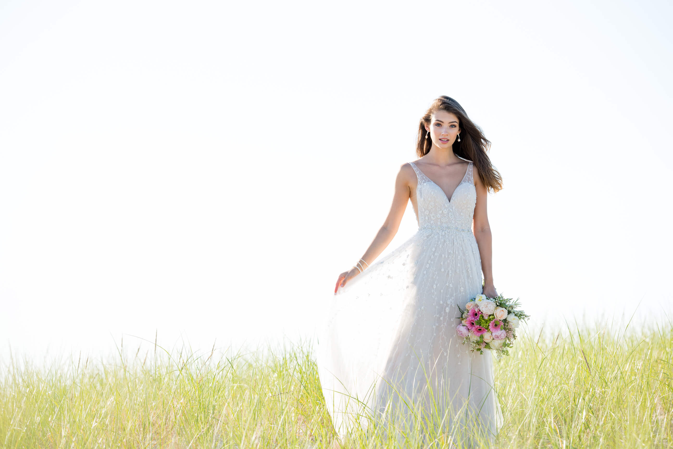 Brunette bride wearing Martin Thornburg wedding dress