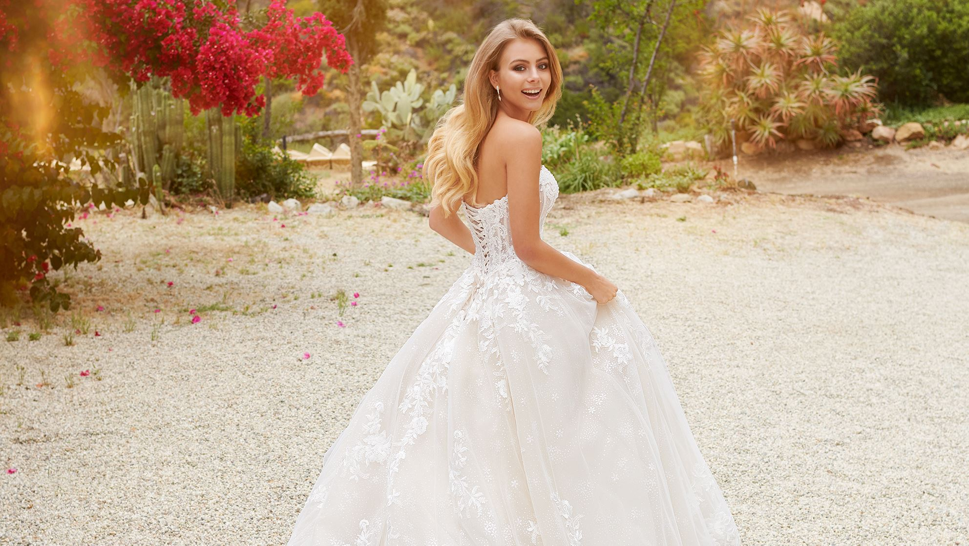 Blonde bride laughing in white ball gown wedding dress