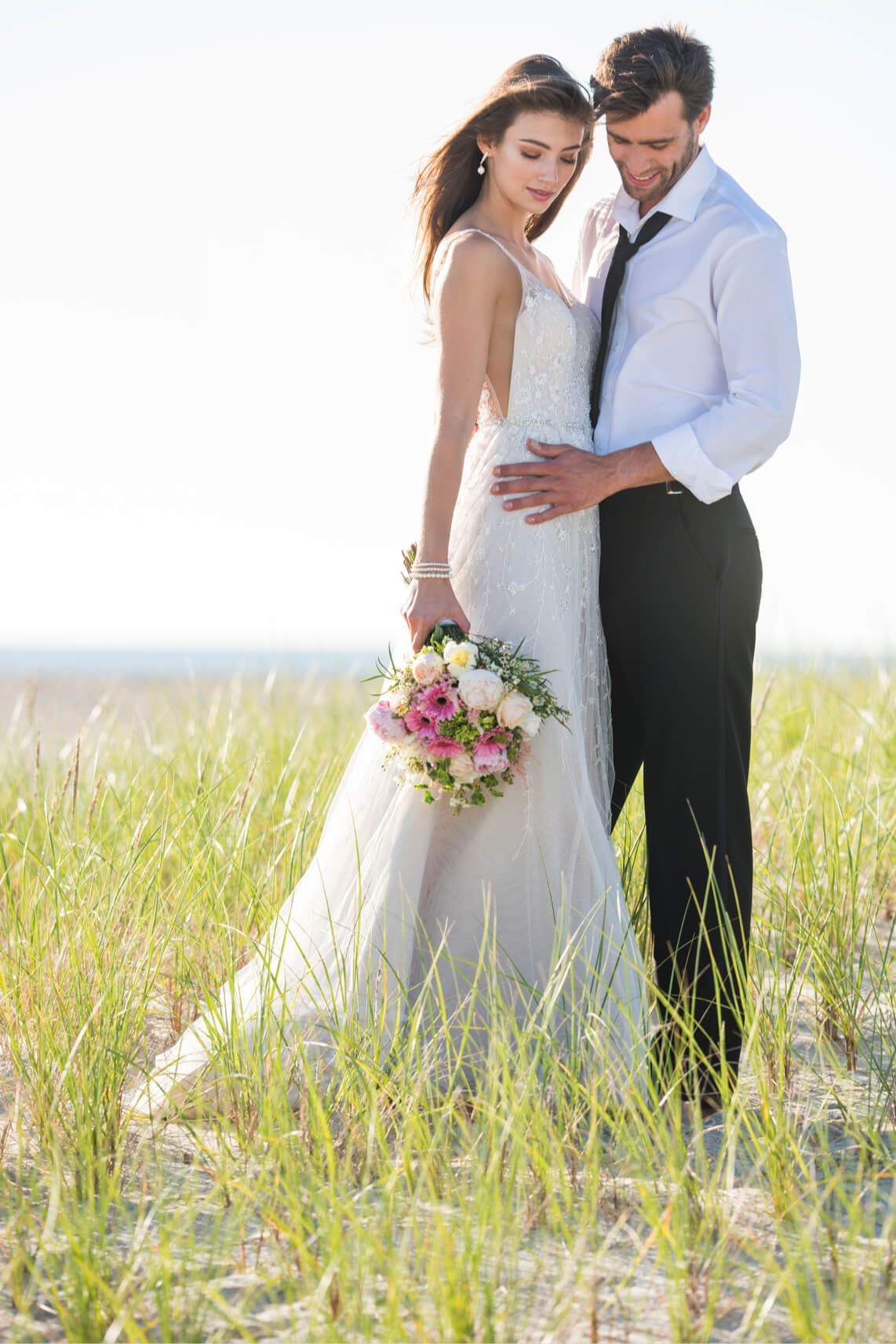 Brunette bride in Martin Thornburg wedding dress with groom